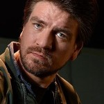 Charles Halford als Chas Chandler in Constantine